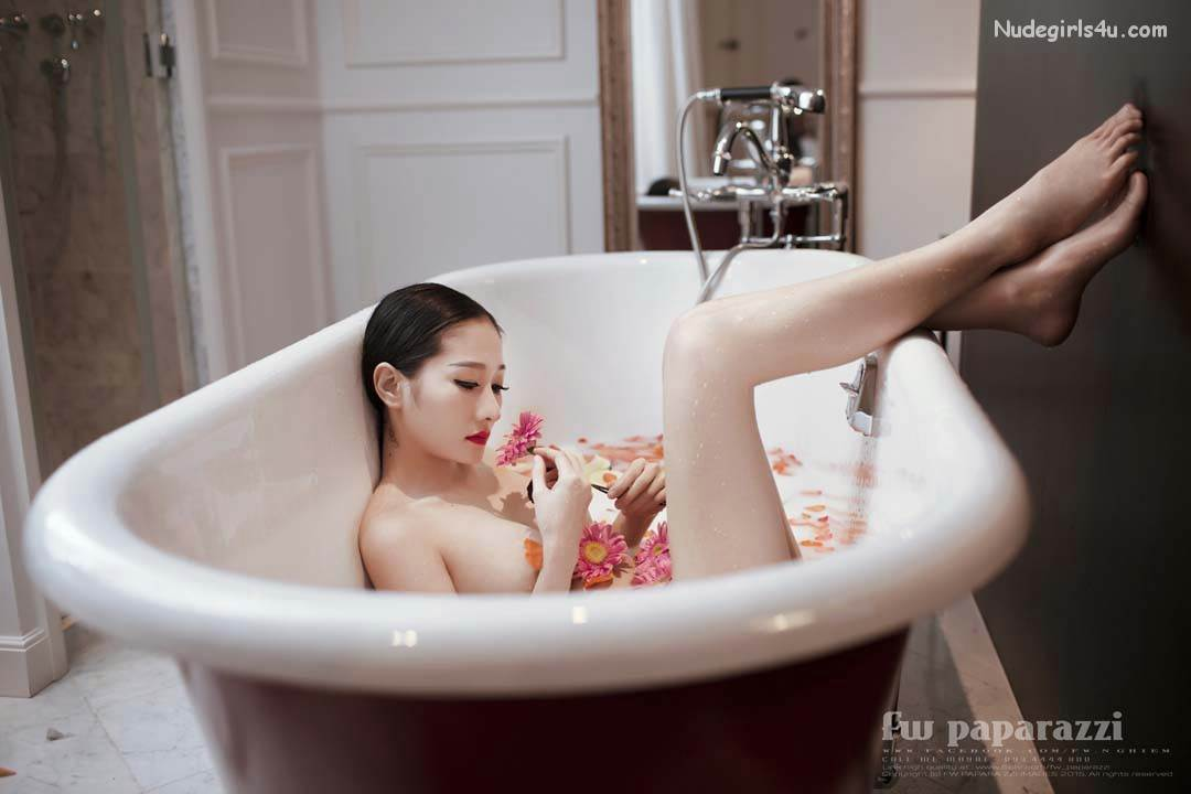Young hot girl bathes bathtub rubs stock photo